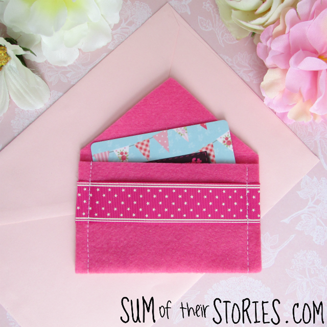 Learn how to make a pretty felt gift card envelope. Tutorial by Sum of their Stories