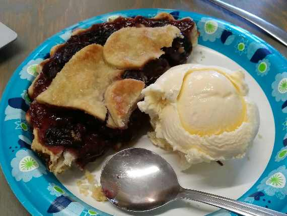 cherry pie and ice cream on paper plate