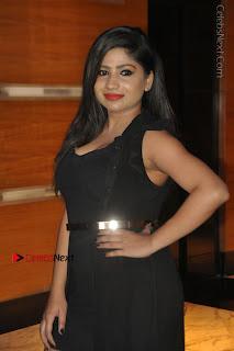 Telugu Actress Model Madhulagna Das Latest Spicy Stills in Black Short Dress  0012.JPG