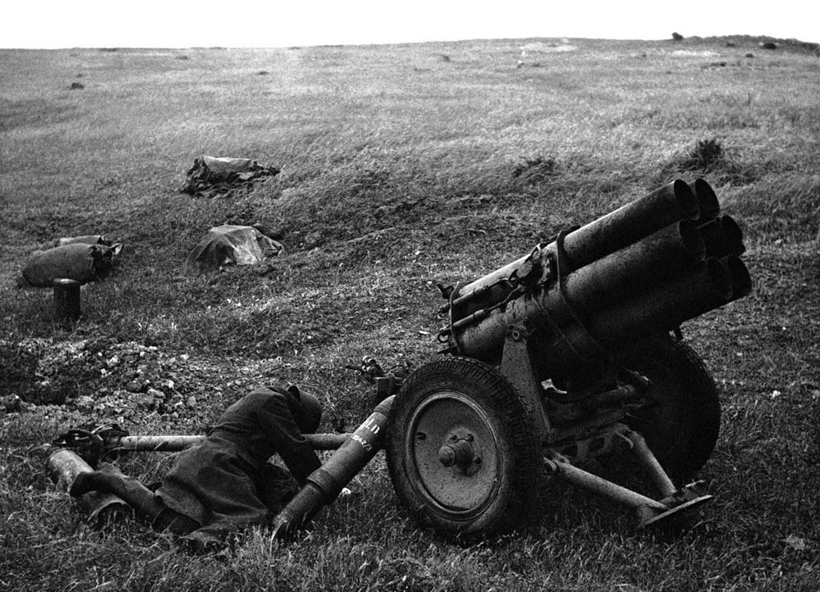 A German soldier lies sprawled against a mortar after a bayonet attack in Tunis, Tunisia, on May 17, 1943.