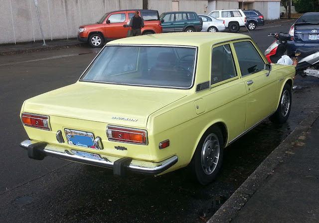 Rear of a Datsun 510 coupe.