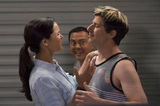 Jake and Amy's awkward reunion kiss is interrupted by Boyle.