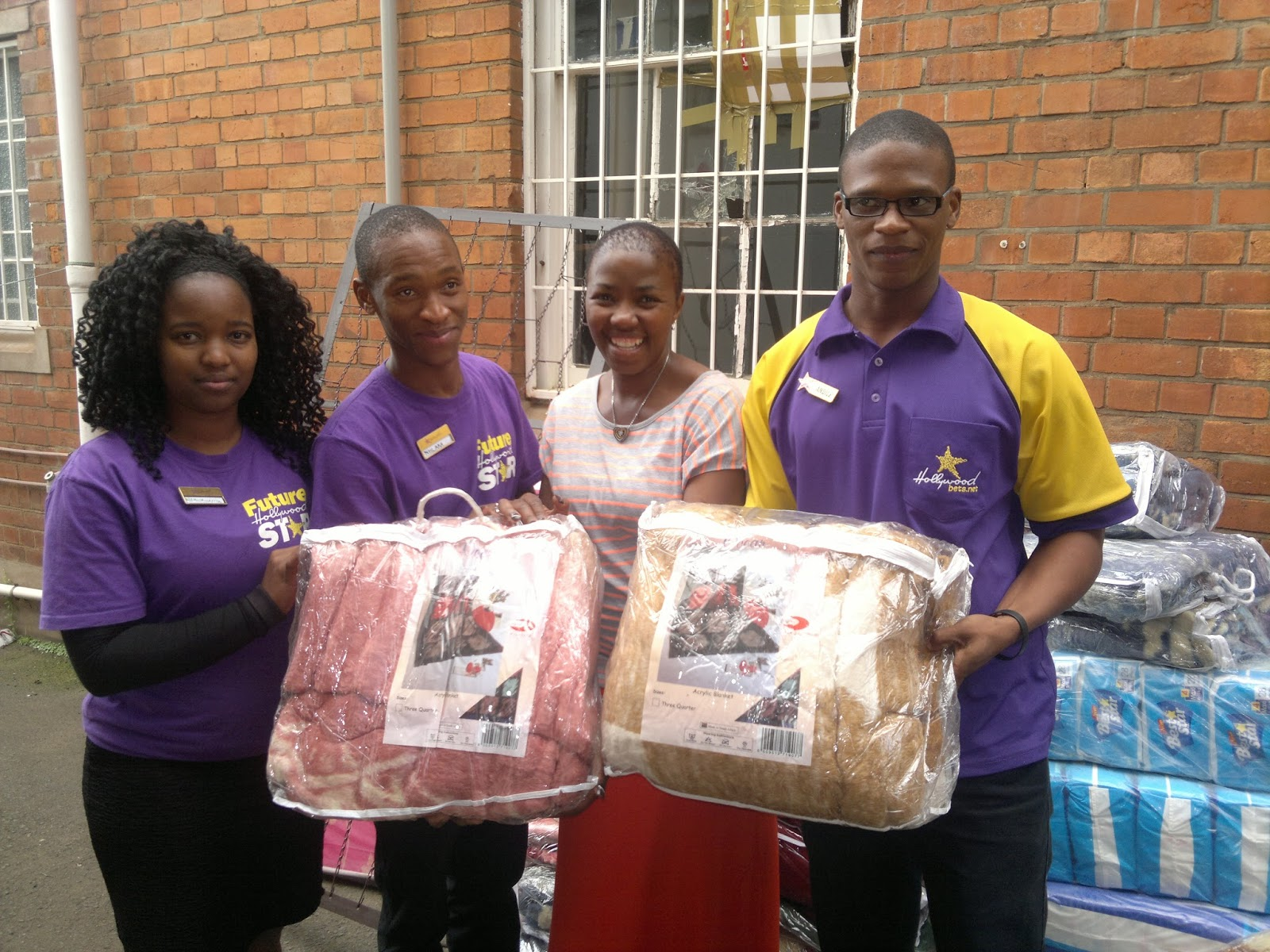 Mbuyisa Racing and Sport team members delivering much-needed items to KwaZulu Natal Christian Council