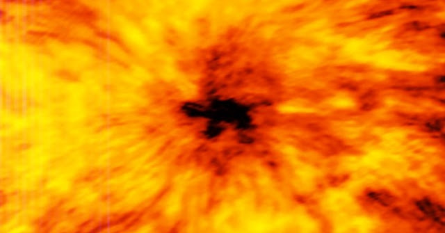 This ALMA image of an enormous sunspot was taken at a wavelength of 1.25 millimetres. Sunspots are transient features that occur in regions where the Sun's magnetic field is extremely concentrated and powerful. They have lower temperatures than their surrounding regions, which is why they appear relatively dark.  These observations are the first ever made of the Sun with a facility where ESO is a partner. They are an important expansion of the range of observations that can be used to probe the mysterious physics of our nearest star.  Credit: ALMA (ESO/NAOJ/NRAO)
