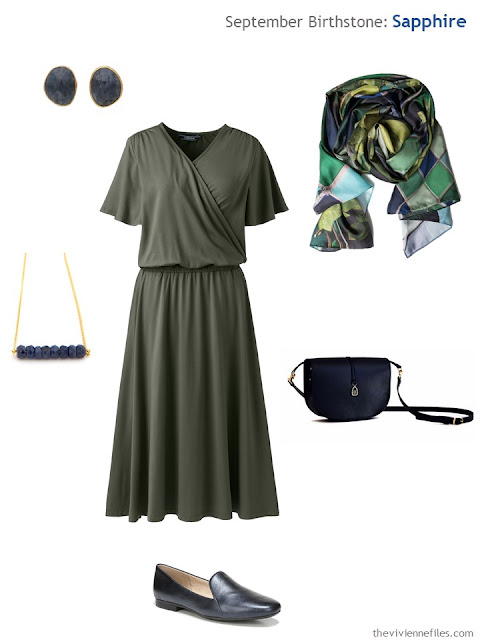 olive dress with sapphire jewelry