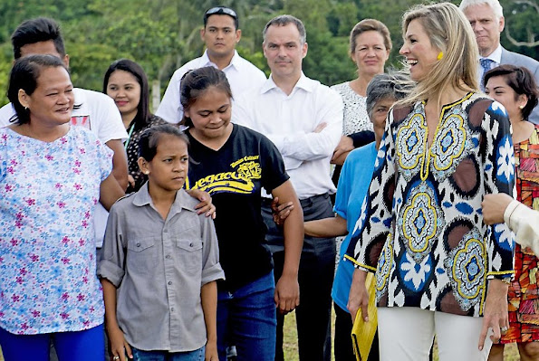 Queen Maxima, is greeted by the Garcia Family