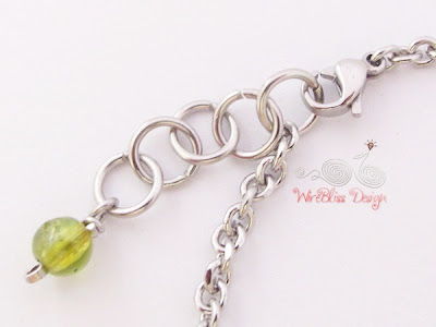 Close up of Peridot Charm and Clasp of Wire Wrapped Minima Bracelet (Minlet)