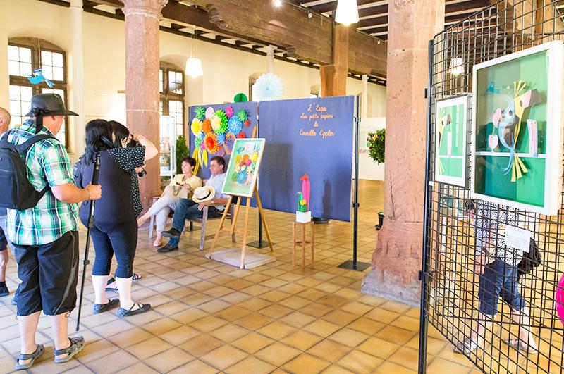 Prise photo de visiteurs durant l'exposition