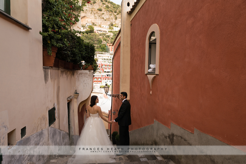 Bride and groom walking in Positano streets