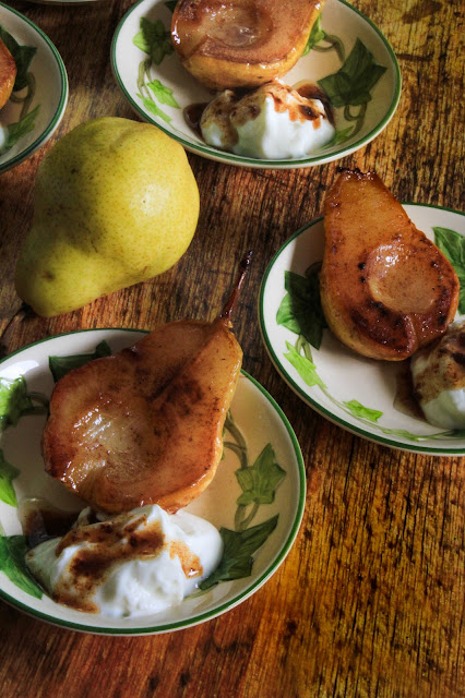 Roasted Cinnamon Buttery Pears, simple dish showcasing the straightforward flavor of pears.  They are buttery slightly sweet served as an accompaniment to pork, garnished in a winter salad, but also makes an elegant dessert for a fall dinner party, bridal brunch and quick weeknight snack.