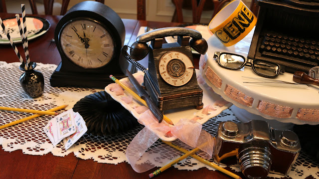 Vintage Spy Centerpiece with clocks, telephones, stampers, glasses, tweezers and more