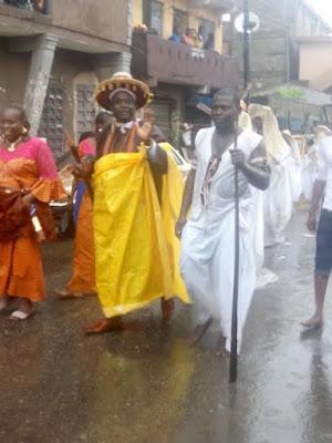 Eyo masquerades defy rainfall, move around in their attire - SEE PHOTOS
