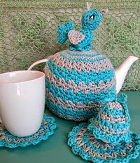 http://www.ravelry.com/patterns/library/tea-cosy-coaster-egg-cosy-set-with-bird
