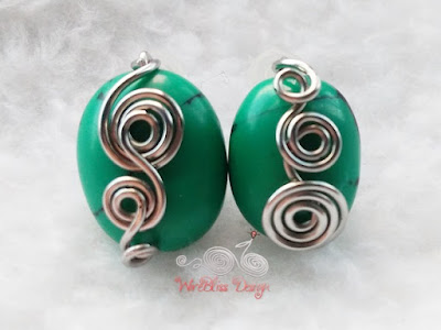 Front view of Turquoise wire wrapped earrings with lots of swirls