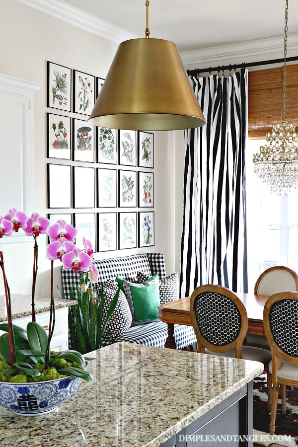 botanical gallery wall, black and white striped curtains, brass alden pendant, vintage chandelier
