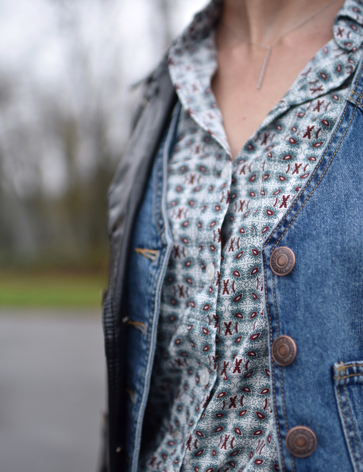 Monika Faulkner outfit inspiration - faux-leather trench, denim vest, patterned shirt
