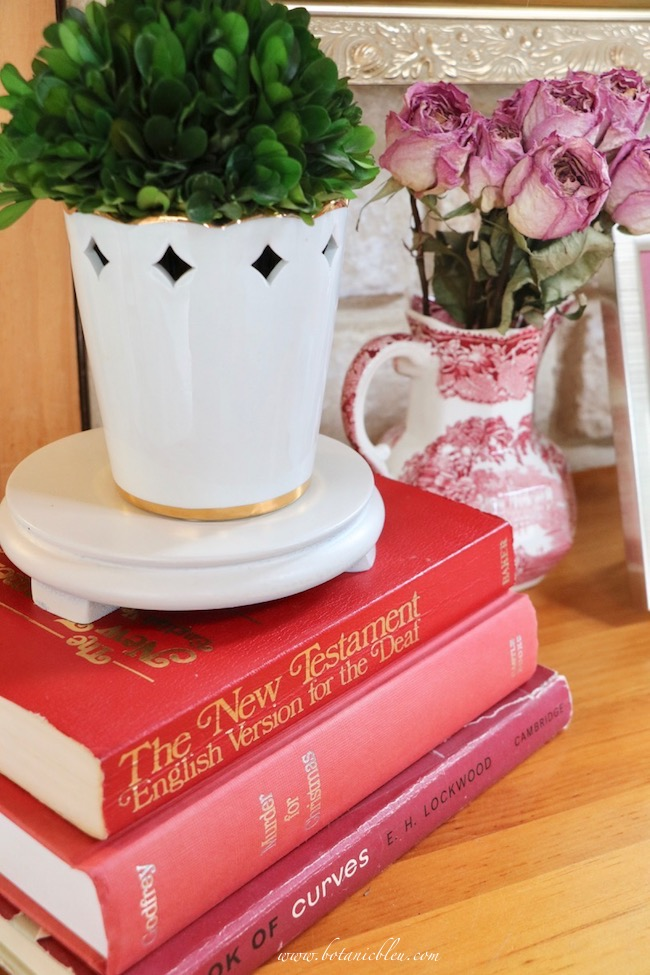 Vintage Valentines display tips with stack of red books