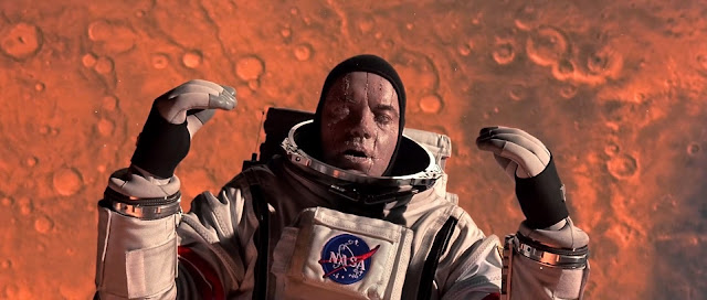 Dead astronaut in Mars orbit - Mission to Mars movie image