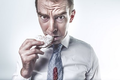 Man eating donut with an unhealthy vegetarian diet