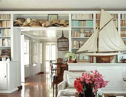 straw hats on shelf by India Hicks