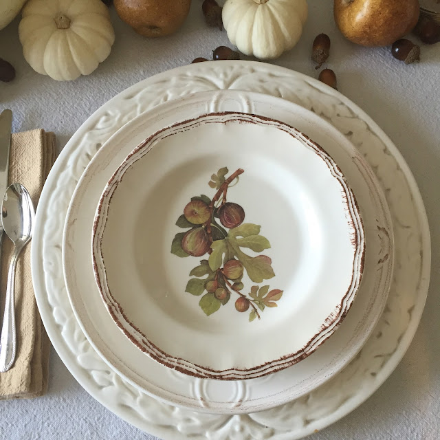 fall tablescape with fig plates white charger and white pumpkins