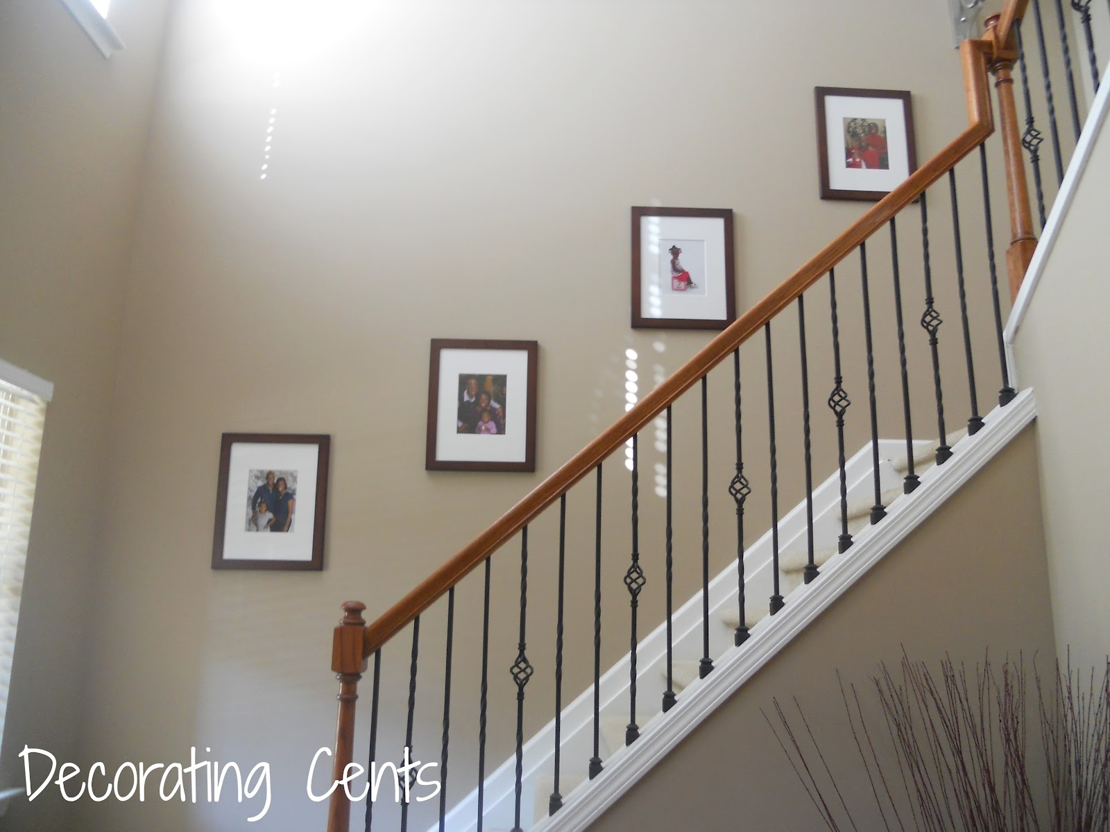 Basement Stair Landing Decorating: Hanging Frames With Double Hooks