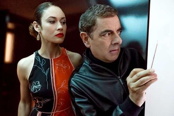 Olga Kurylenko e Rowan Atkinson