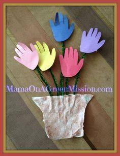 Idea to make flowers from paper handprint for kids 1