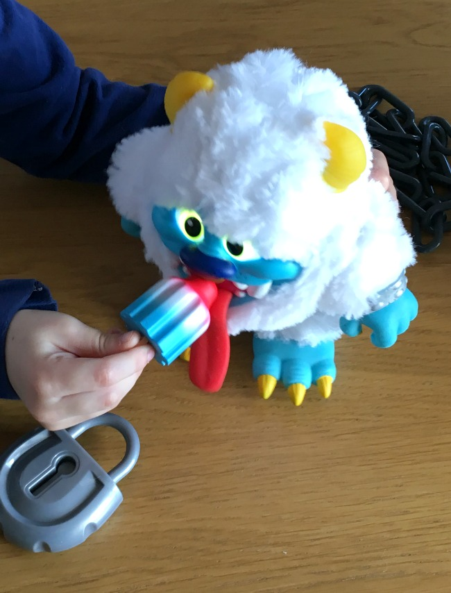 Crate-Creatures-Surprise-Blizz-Review-boy-feeding-ice-lolly-to-Blizz