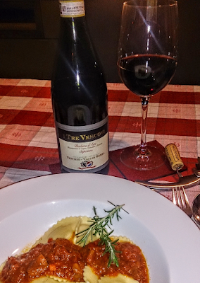 A bottle of Barbera d'Asti DOCG wine paired with ravioli filled with a pastry of truffles