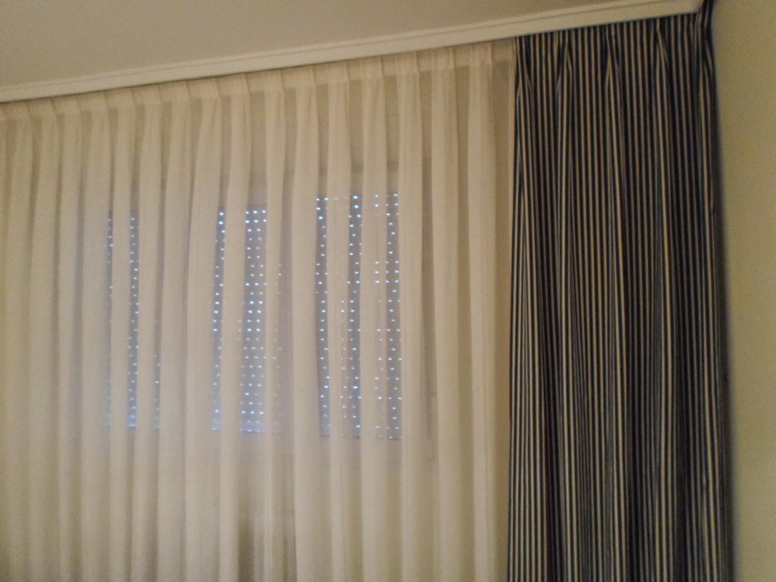 Tapicer a carrasco asturias combinando lo nuevo y lo for Ganchos para cortinas de riel