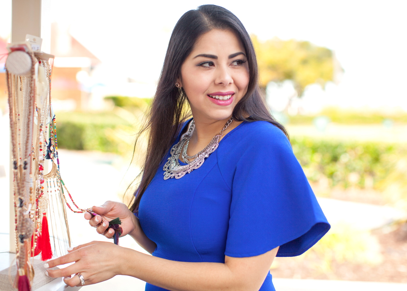 latina fashion blogger, silver statement necklace, necklaces that go with blue, bold blue dress, too faced chihuahua lip