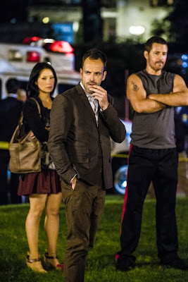 Ted King as James Monroe with Jonny Lee Miller and Lucy Liu as Sherlock Holmes and Joan Watson in CBS Elementary Season 2 Episode 6 An Unnatural Arrangement