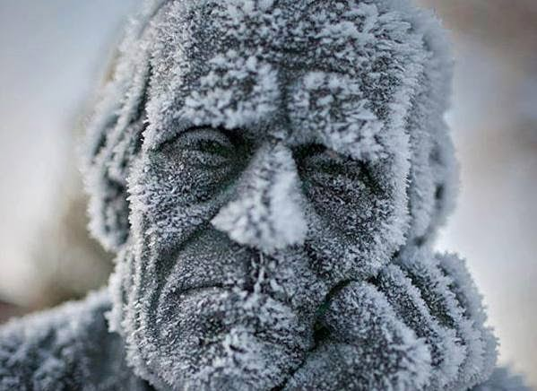 A frozen, kind of depressed statue. - The 30 Most Amazing Photos Of Frozen Things In Honor Of The Coldest Morning Of The 21st Century