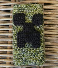 http://www.ravelry.com/patterns/library/minecraft-creeper-phone-cozy-cover