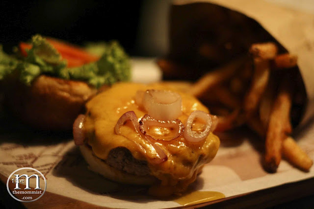 Burger patty with melted cheese and french fries
