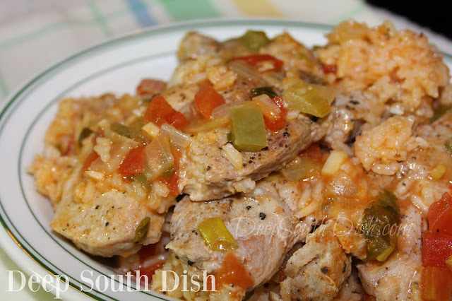 raditional rice jambalaya, made Creole-style with the trinity, garlic and tomatoes, with seasoned pan-seared, bone-in pork chops nestled in.