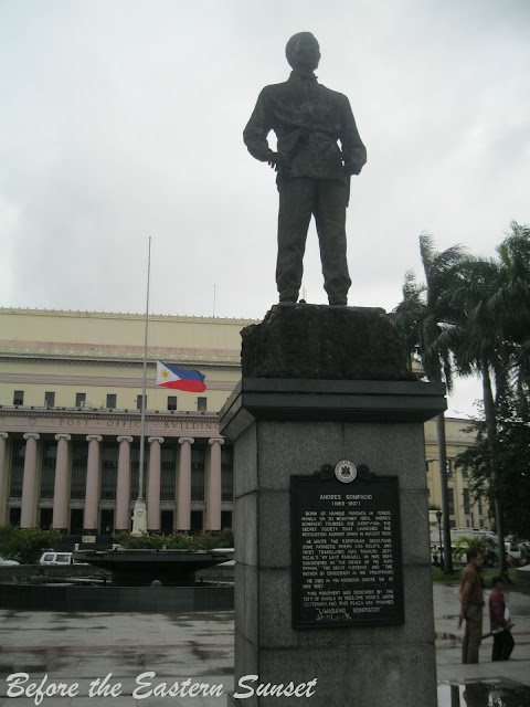 Statue of Andres Bonifacio with Manila Central Post Office at the background.