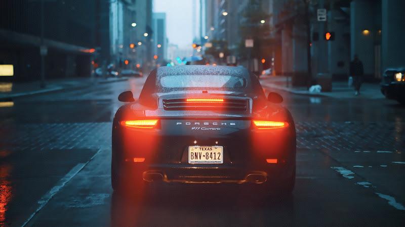 Porsche 911 Carrera on Rainy Streets