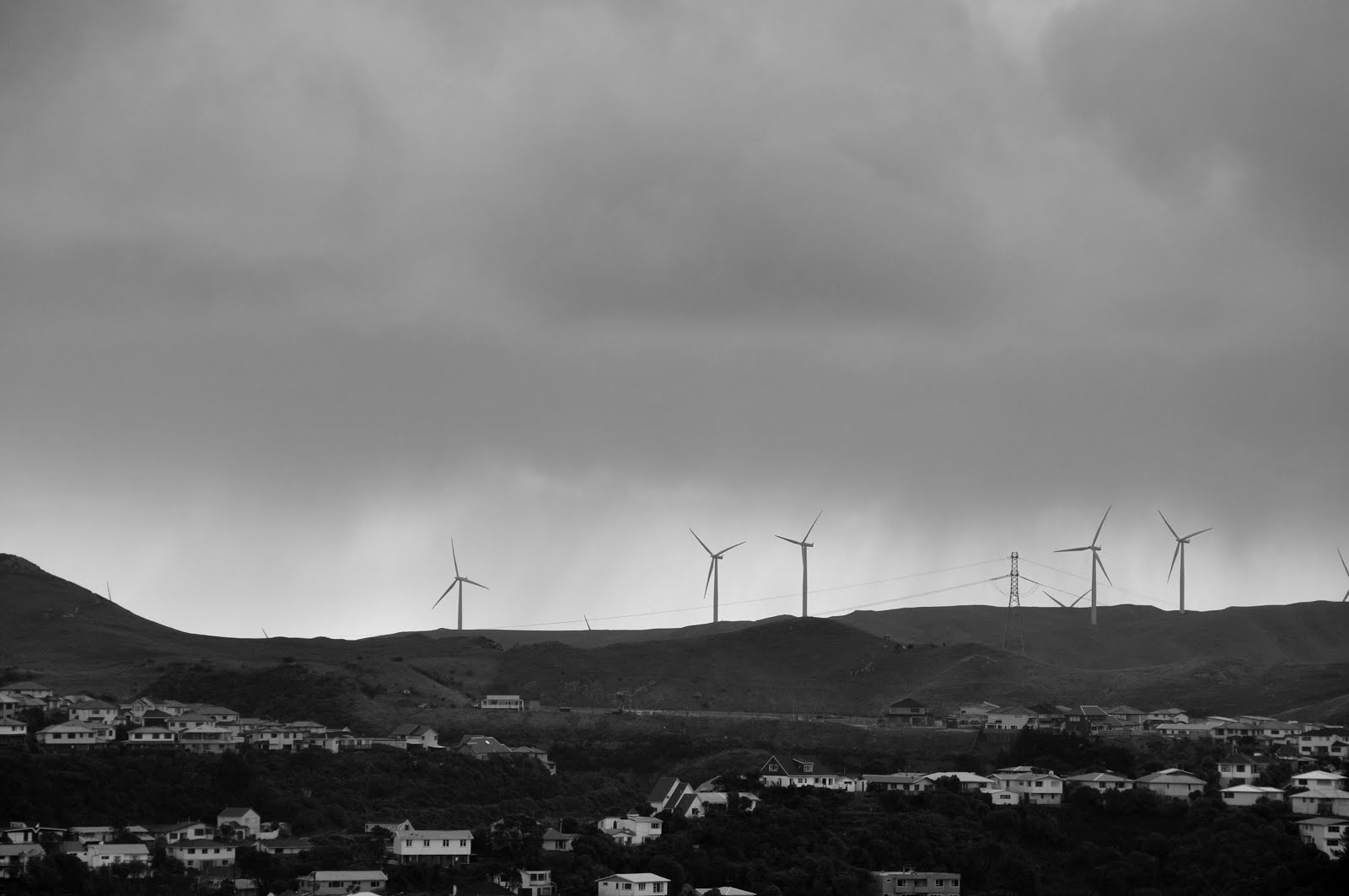 Looking west to spinning wind turbines on a cold grey afternoon