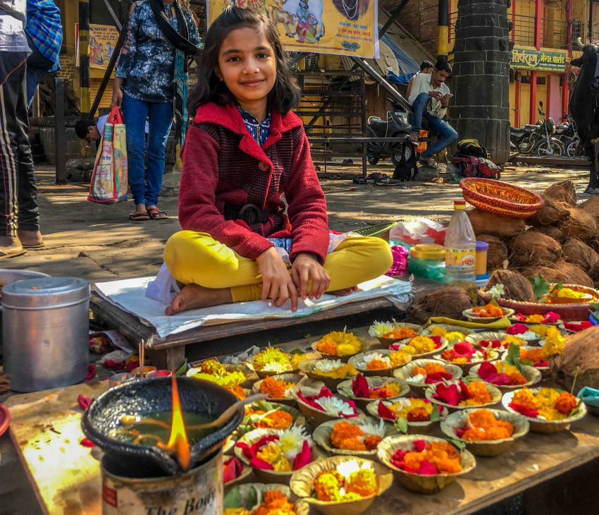 A girl selling Flowers Near Kushavart Kund