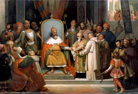 Charlemagne receiving manuscripts from his tutor, the monk Alcuin
