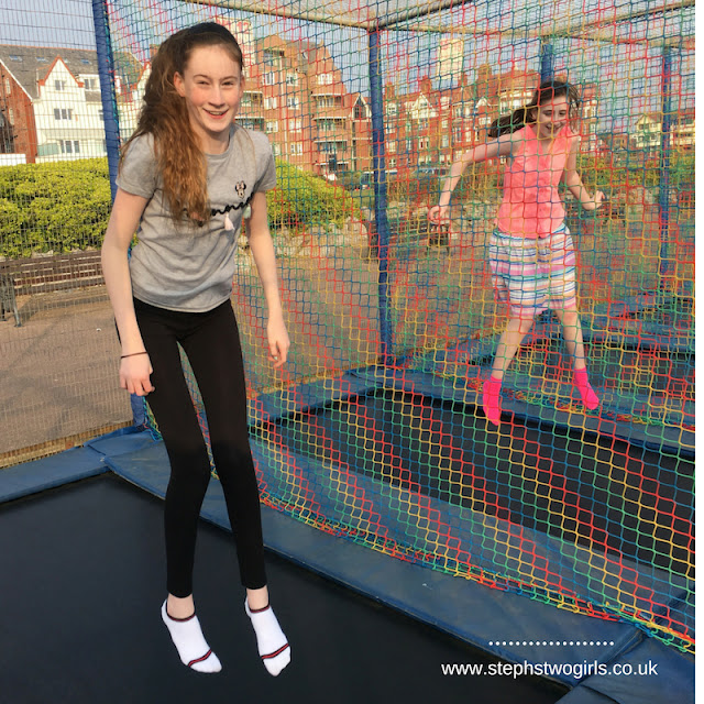 stephs two girls on trampolines