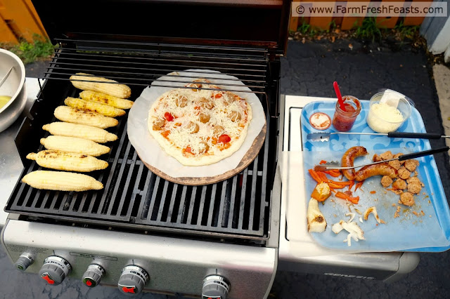 overview of grilling sausage and peppers pizza