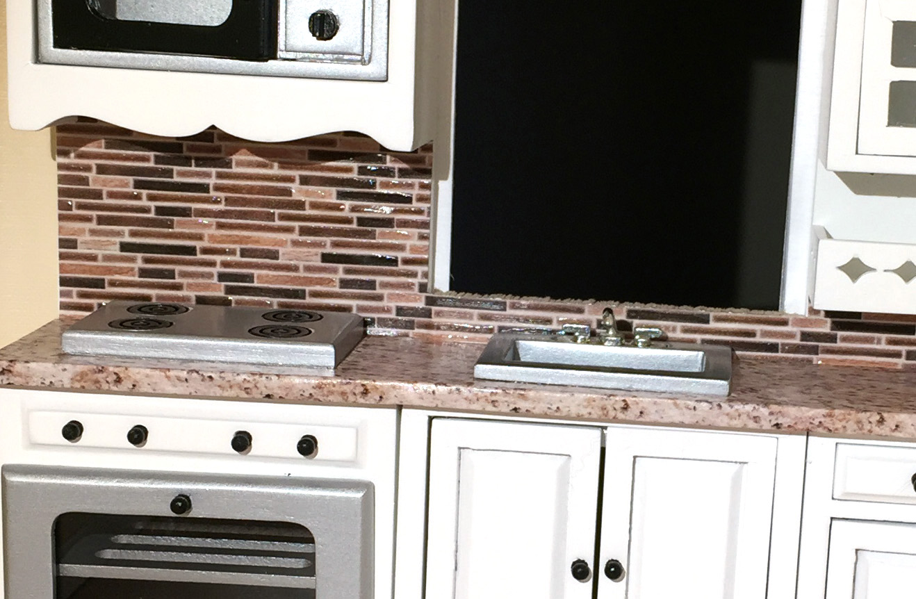 Dollhouse backsplash and counter the kinfeld for Pre built kitchen units