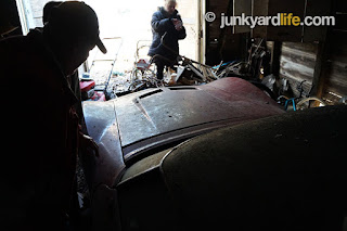 Mike shuffles in the darkened building that has housed his Corvette for 42 years.