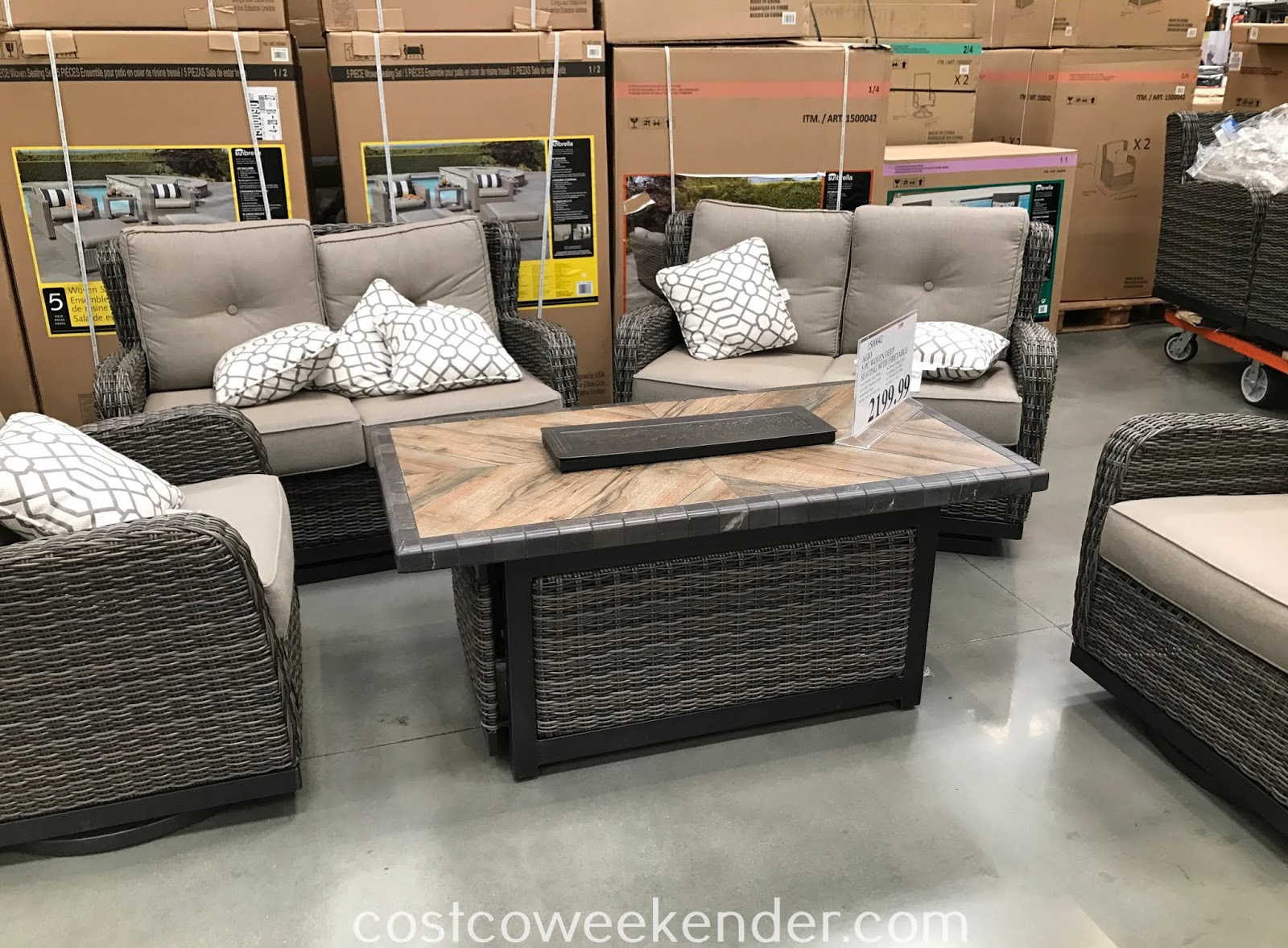 Relax the afternoon away with the Agio 5-piece Woven Deep Seating Set with Fire Table