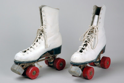 White rollerskates with red wheels