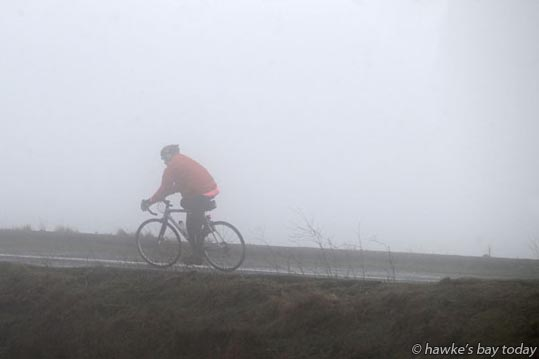 Kevin Jury, Havelock North, cycles up Te Mata Peak every Thursday on his day off - Cloud covered Te Mata Peak, Haveock North, after light showers, weather in Hawke's Bay. photograph