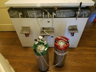 Jumping from the carbonating keg (right) to the serving keg (left).